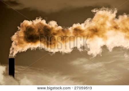 power plant in clouds belching heavy smoke in dramatic sky