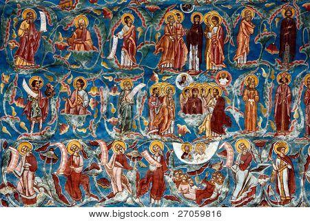 old religious paintings on moldovita monastery wall, romania, unesco world heritage