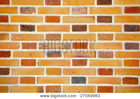 brick wall background with different colored tiles