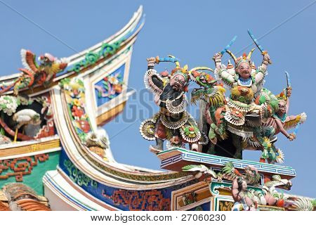 beautiful buddhism sculptures on Cheng Hoon Teng temple roof, Melaka, Malaysia