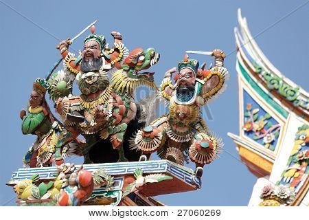 beautiful buddhism sculptures on Cheng Hoon Teng temple roof, Melaka, Malaysia