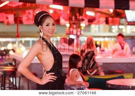 thai ladyboy posing in gogo bar, pattaya, thailand