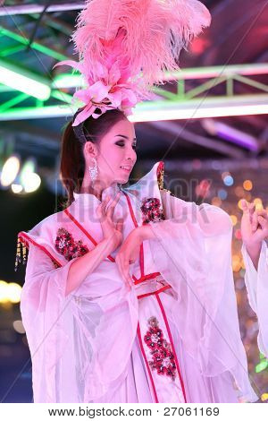 thai ladyboy dancing on stage during night show, pattaya, thailand