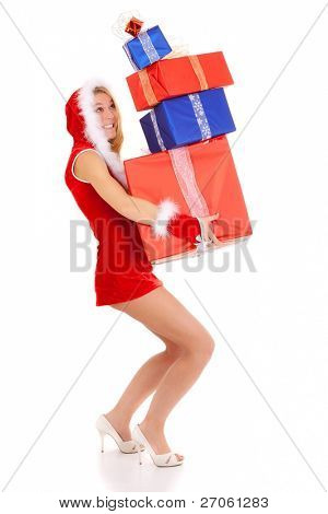 sexy christmas woman carrying gift pile isolated on white