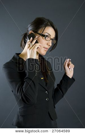 attractive businesswoman with mobile phone