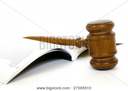 Wooden gavel from the court and law book