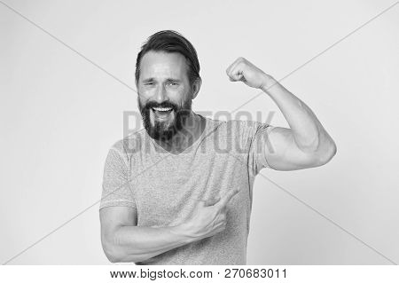 poster of Fitness Result. Man Show On Muscle As Result After Fitness Training. Fitness Result Of Happy Man. Ma