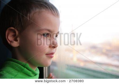 Little Boy Looks In Train`S Window
