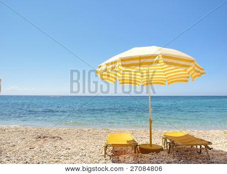 Sunchairs and umbrella on Carribean Beach