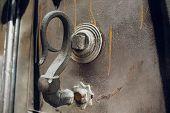 Door Handles With An Old Double Door. Golden Handle Door Entrance. Luxury Gold Handle. Classical Sty poster