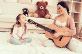 Kids Home Games. Rest At Home. Child Development. Mom And Daughter Play. Happy Mom And Child In Paja poster