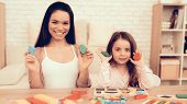 Mother Teaches Daughter. Educational Games. Learning Child At Home. Cubes In Hands. Child Developmen poster