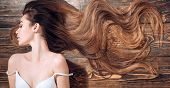 Beauty Hair Salon. Woman With Long Beautiful Hair. Fashion Haircut. Beauty Girl With Long And Shiny  poster