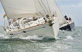 Two beautiful white yachts, sailboats or sail boats sailing or racing at sea  poster