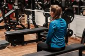 A Fitness Girl Having A Break After A Hard Workout. Workout, Woman, Blue Gym Clothes; poster