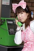 picture of lolita  - japanese girl in sweet lolita cosplay style phoning - JPG