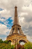 Eiffel Tower At Sunset In Paris, France. Romantic Travel Background. Eiffel Tower Is Traditional Sym poster