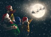 Merry Christmas and happy holidays! Cute little children with mom, dad, grandma and grandpa. Santa C poster