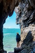 Travel People Lifestyle Women Tourist In Summertime And Vacations Trip In The Cave Near Sea In Keo S poster