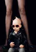 Rock It. Adorable Little Music Fan. Small Boy At Female Legs. Rock Style Child. Little Rock Star. Sm poster