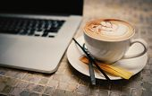 A Cup Of Cappuccino Coffee With Laptop On Table. Royalty High Quality Free Stock Image Of Capuccino  poster