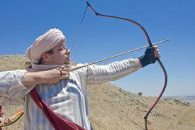 pic of saracen  - A man clad as a Saracen aiming his bow - JPG