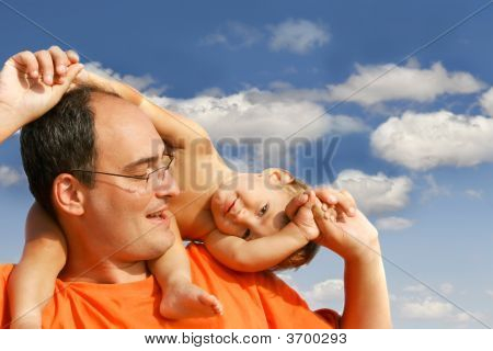 Father And Son On Sky Background