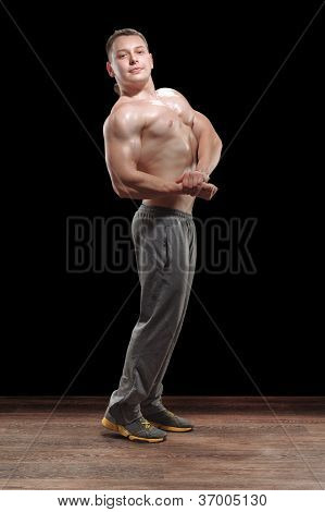 Healthy Muscular Young Man In Studio