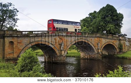 A Bus On An Old Bridge In England