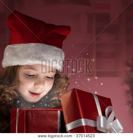 little girl open red gift box