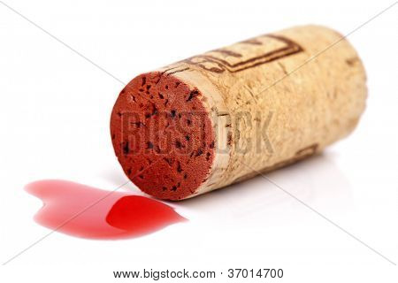 Cork with spilt red wine isolated on white