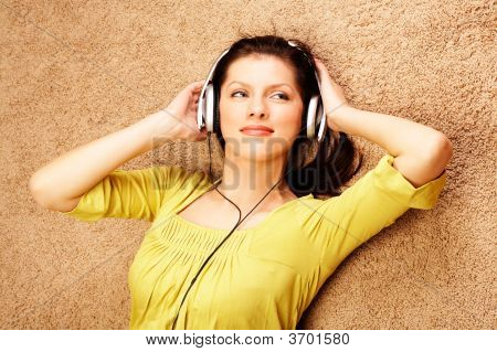Beautiful Women Listening Music In Headphones
