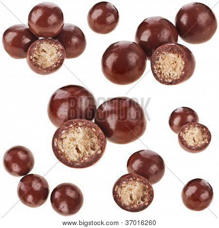 Chocolate candy balls  with crisp filling isolated on white  background