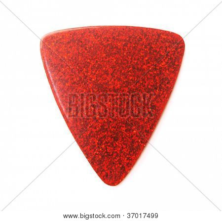 Red metallic or sparkle guitar pick, isolated on white.