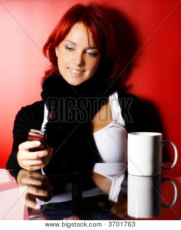 Young Woman With Cell Phone Over Red