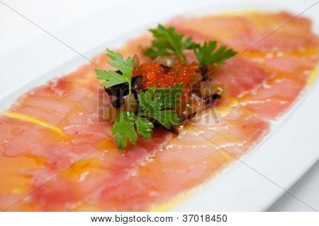 Salmon carpaccio with rocket salad