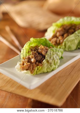 Asian lettuce wrap with minced chicken and seasonings
