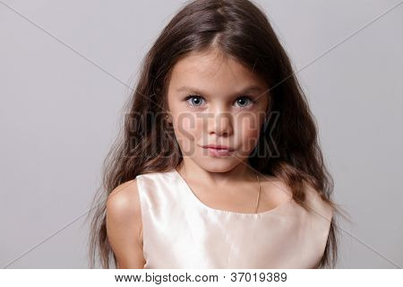 close-up portrait of a little amazing girl with blue eyes and opening mouth isolated on white