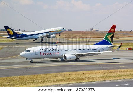 JOHANNESBURG - APRIL 18:Boeing 737 taxing after domestic flight on April 18, 2012 in Johannesburg, South Africa. Johannesburg Tambo airport is the busiest airport in Africa