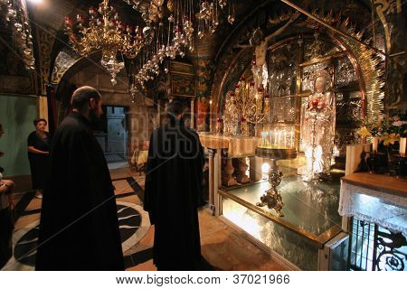 JERUSALEM - JANUARY 02: Via Dolorosa, 12th Stations of the Cross. The pilgrims who visit the Holy Land, pass the path that Jesus carried the cross to Calvary. Jerusalem on January 02, 2008.