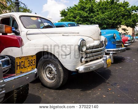 HAVANA-SEPTEMBER 13:Group of old shabby cars September 13,2012 in Havana.Thousands of these cars are used in Cuba by private taxi drivers who need to manufacture or adapt parts to keep them running