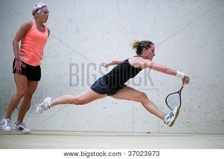 BUKIT JALIL, MALAYSIA - SEPTEMBER 11: Natalie Grinham defeats Lisa Aitken (orange) at the CIMB Malaysian Open Squash Championship 2012 on September 11, 2012 at the National Squash Centre, Malaysia.