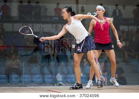 BUKIT JALIL, MALAYSIA  - SEPTEMBER 12: Low Wee Wern (white) defeats Madeline Perry at the CIMB Malaysian Open Squash Championship 2012 on September 12, 2012 at the National Squash Centre, Malaysia.