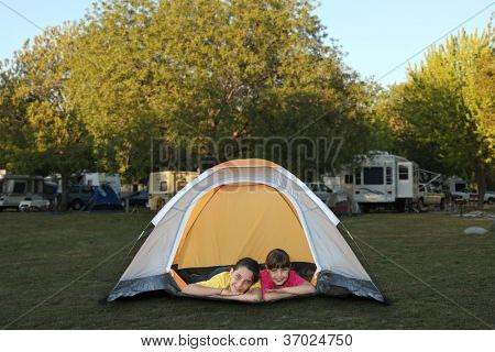 Family at a Campground Inside a Tent Smiling