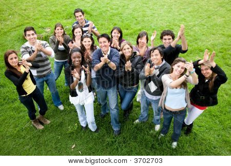 Casual Friends Clapping In The Park