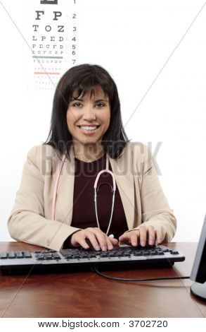Doctor Or Optometrist At Desk
