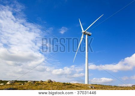 Windmill in the top of a mountain against beautiful sky