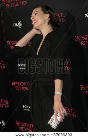 LOS ANGELES - SEP 12:  Milla Jovovich arrives at the