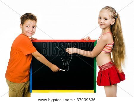 beautiful boy and girl with a board. stodio shot