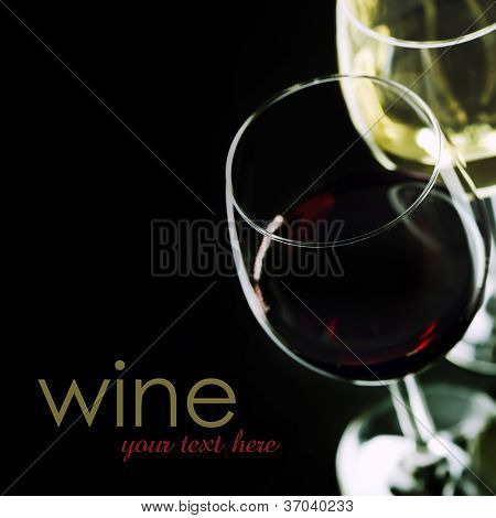Glasses of  wine on black background  (easy removable sample text)